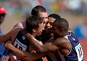 From left: Chris Lukezic, Jesse O'Connell, Ali Najjar and Erza Richards embrace after Georgetown's victory in the College Championship of America men's 4 x 800-meter relay (7:13.75) in the 110th Penn Relays at  Franklin Field on Saturday, April 24, 2004 in Philadelphia.
