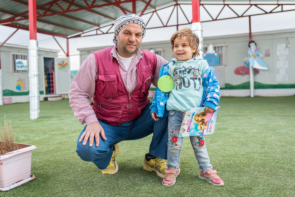 20 February 2020, Za'atari Camp, Jordan: Four-year-old Hajar Abas-Abas and her father Abas-Abas visit the Smurf Centre, a daycare centre operated by the Lutheran World Federation in the Za'atari Camp for Syrian refugees. The centre is intended to help empower women in the camp by giving them space to attend life skills trainings or other activities. For Hajar, however, spending time at the Smurf Centre has had a profound impact, as she had been falling behind in development of her speaking abilities, something that has come to develop much more quickly after coming to the Smurf Centre.