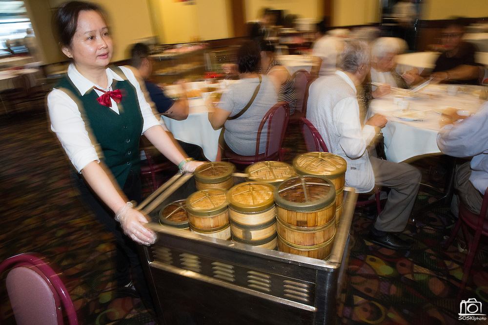 A server showcases various baskets of Dim Sum at Great Mall Mayflower Restaurant in Milpitas, California, on September 11, 2014. (Stan Olszewski/SOSKIphoto)