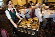 A server showcases various baskets of Dim Sum at Great Mall Mayflower Restaurant in Milpitas, California, on September 11, 2014. (Stan Olszewski/SOSKIphoto)