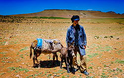 A shepherd with his donkeys looking after a flock of goats and sheep in the Atlas Mountains, MOrocco<br /> <br /> (c) Andrew Wilson   Edinburgh Elite media