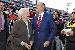 Former President George H.W. Bush, and former first lady Barbara Bush on the field before Super Bowl XXXIX on Sunday, February 6, 2005. Photo By Lionel Hahn/ABACA.