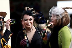 Female racegoers enjoy a drink during St Patrick's Thursday of the 2018 Cheltenham Festival at Cheltenham Racecourse.