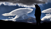 Silhouette and lenticular clouds in Patagonia. Image taken with a Fuji X-T1 camera and 55-200 mm lens (ISO 200, 55 mm, f/16, 1/500 sec).