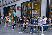 With many people and families staying in the UK for their Summer break during the school holidays, a large number of domestic tourists, who may normally have been travelling abroad, have decended on the capital to see the sights, as seen here outside the Lego store in Leicester Square on 10th August 2021 in London, United Kingdom. Following the Coronavirus / Covid-19 health scare of the last two years, and with some travel restrictions still in place, more people have chosen a staycation which is a holiday spent in ones home country rather than abroad, or one spent at home and involving day trips to local attractions.