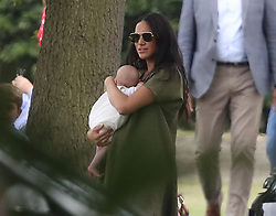 File photo dated 10/07/19 of the Duchess of Sussex holding her son Archie as they attended the King Power Royal Charity Polo Day at Billingbear Polo Club, Wokingham, Berkshire. Archie Mountbatten-Windsor, who is the Queen and the Duke of Edinburgh's eighth great-grandchild, is celebrating his first birthday today.