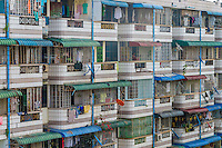 YANGON, MYANMAR - CIRCA DECEMBER 2013: View of the facade of a typical apartment building in the city of Yangon.