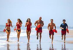 RELEASE DATE: May 26, 2017 TITLE: Baywatch STUDIO: Paramount Pictures DIRECTOR: Seth Gordon PLOT: Two unlikely prospective lifeguards vie for jobs alongside the buff bodies who patrol a beach in California STARRING: Kelly Rohrbach as CJ Parker, Alexandra Daddario as Summer, Ilfenesh Hadera as Stephanie Holden, Dwayne Johnson as Mitch Buchannon, Zac Efron as Matt Brody and Jon Bass as Ronnie. (Credit: © Paramount Pictures/Entertainment Pictures/ZUMAPRESS.com)