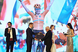Sierk-Jan de Haan receives van der Breggen's award for becoming road world champion at The UCI Cycling Gala 2018 in Guilin, China on October 21, 2018. Photo by Sean Robinson/velofocus.com