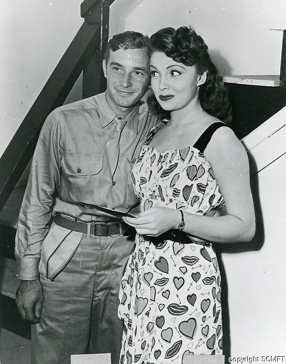 1944 Joan Leslie and a serviceman pose at the Hollywood Canteen