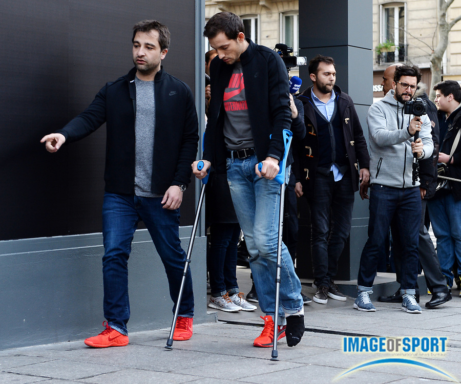 Feb 17, 2014; Paris, France; Renaud Lavillenie (FRA) arrives at press conference on crutches with a laceration on his left ankle after setting a world record of 20-2 1/2 (6.16m). Photo by Jiro Mochizuki