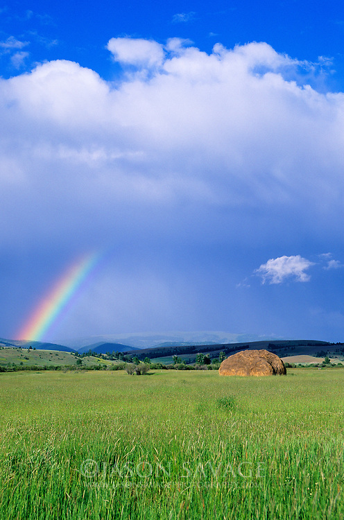 Hay and rainbow near Avon, Montana.