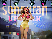 "29 APRIL 2017 - MINNEAPOLIS, MINNESOTA: A ""ladyboy"" (drag queen) performance at the Songkran Uptown festival. Several thousand people attended Songkran Uptown on Hennepin Ave in Minneapolis for the city's first celebration of Songkran, the traditional Thai New Year. Events included a Thai parade, a performance of the Ramakien (the Thai version of the Indian Ramayana), a ""Ladyboy"" (drag queen) show, and Thai street food.     PHOTO BY JACK KURTZ"
