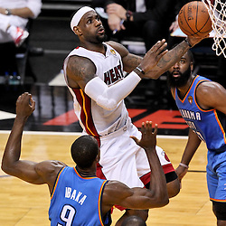 Jun 21, 2012; Miami, FL, USA; Miami Heat small forward LeBron James (6) shoots over Oklahoma City Thunder power forward Serge Ibaka (9) and guard James Harden (13) during the second quarter in game five in the 2012 NBA Finals at the American Airlines Arena. Mandatory Credit: Derick E. Hingle-US PRESSWIRE