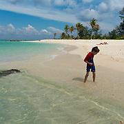 Small kid playing on the beach of Koh Lipe island, Thailand