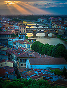 Sunset from Piazzale Michelangelo in Firenze (Florence), Italy.<br /> -----<br /> Captured with a Canon 5D Mk III camera and Canon EF 70-200/4L IS lens  <br /> -----<br /> Florence (Italian: Firenze) is the capital city of the Italian region of Tuscany and of the province of Florence. It is the most populous city in Tuscany, with approximately 370,000 inhabitants, expanding to over 1.5 million in the metropolitan area.<br /> Florence is famous for its history. A centre of medieval European trade and finance and one of the wealthiest cities of the time, Florence is considered the birthplace of the Renaissance, and has been called the Athens of the Middle Ages. A turbulent political history includes periods of rule by the powerful Medici family, and numerous religious and republican revolutions. From 1865 to 1871 the city was also the capital of the recently established Kingdom of Italy.<br /> The historic centre of Florence attracts millions of tourists each year, and Euromonitor International ranked the city as the world's 72nd most visited in 2009, with 1,685,000 visitors. It was declared a World Heritage Site by UNESCO in 1982. Due to Florence's artistic and architectural heritage, it has been ranked by Forbes as one of the most beautiful cities in the world, and the city is noted for its history, culture, Renaissance art and architecture and monuments. The city also contains numerous museums and art galleries, such as the Uffizi Gallery and the Pitti Palace, amongst others, and still exerts an influence in the fields of art, culture and politics.<br /> Florence is also an important city in Italian fashion, being ranked within the top fifty fashion capitals of the world; furthermore, it is also a major national economic centre, being a tourist and industrial hub. In 2008, the city had the 17th highest average income in Italy.
