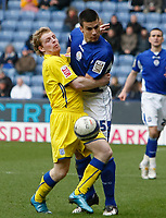 Photo: Steve Bond/Richard Lane Photography. Leicester City v Cardiff City. Coca Cola Championship. 13/03/2010. Bruno Berner (R) and Chris Burke tangle