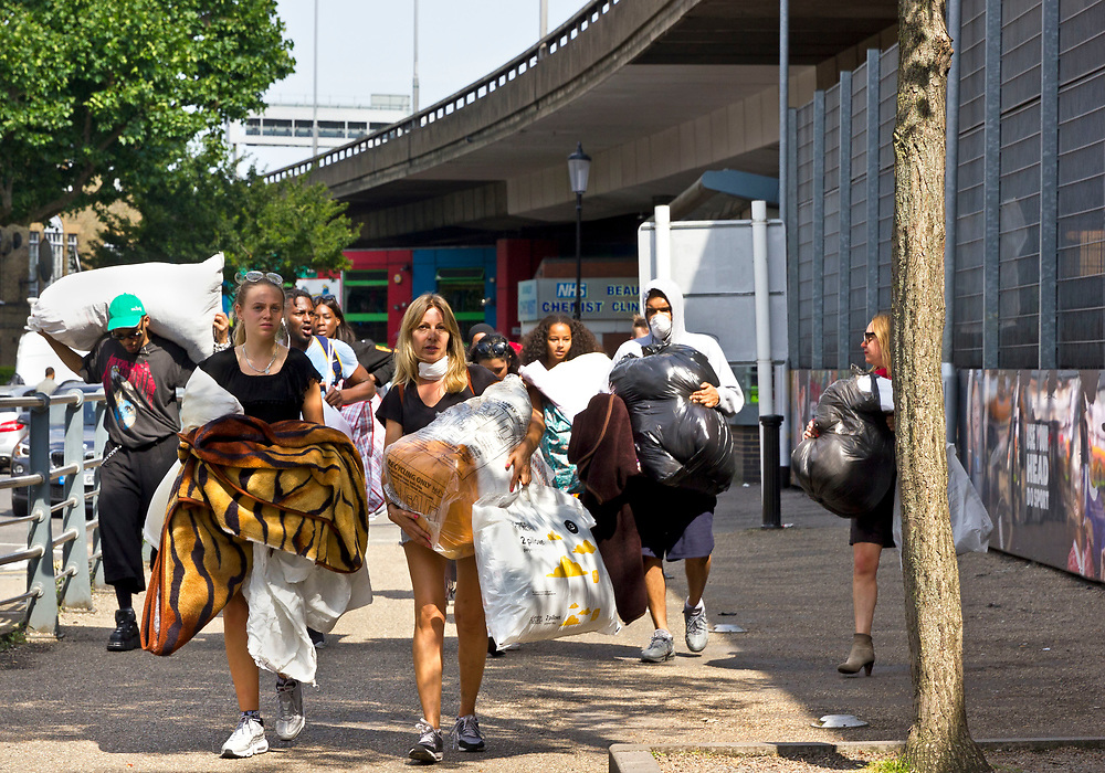 14 June 2017 taken between the hours of 16.27 - 18.50.<br /> <br /> Volunteers carrying donations to the Westway sports and fitness centre. <br /> <br /> Grenfell Tower fire occurred on 14 June 2017 at the 24-storey, 220-foot-high (67 m), tower block of public housing flats in North Kensington, Royal Borough of Kensington and Chelsea, West London. It caused at least 80 deaths and over 70 injuries. A definitive death toll is not expected until at least 2018. As of 5 July 2017, 21 victims had been formally identified by the Metropolitan Police. Authorities were unable to trace any surviving occupants of 23 of the flats. ( Source Wikipedia}