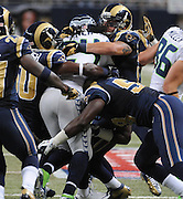 Football - NFL- Seattle Seahawks at St. Louis Rams.Rams tacklers mob Seattle Seahawks running back Marshawn Lynch (24) in the third quarter at the Edward Jones Dome in St. Louis.  The Rams defeated the Seahawks, 19-13.