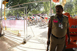 GV of security force and safety fence as the riders pass by during the women's cycling road race through the streets of Delhi held as part of the XiX Commonwealth Games in New Delhi, India on the 10 October 2010..Photo by: Ron Gaunt/photosport.co.nz