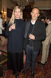 Artist JAMES WHITE and his wife BELINDA WHITE at a cocktail reception hosted by the Woolmark Company, Pierre Lagrange and the Savile Row Bespoke Association to celebrate 'The Ambassador's Project' for London Collections Mens at Marks Club, Charles street, London on 8th January 2016.