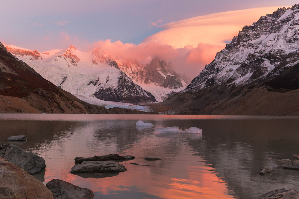 """Colorful sunrise over Cerro Torre in Argentina Patagonia<br /> <br /> 18"""" x 12"""" <br /> <br /> See pricing page for details.<br /> <br /> Please contact me for custom sizes and print options including canvas wraps, metal prints, assorted paper options, etc. <br /> <br /> I enjoy working with buyers to help them with all their home and commercial wall art needs."""