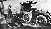World War I: Volunteer English woman driver washing down her ambulance, a converted Wolseley, donated towards the war effort: Cambridge 1915 .
