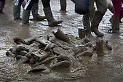 Lost boots sinking in a sea of mud caused by continual rain in the Glastonbury Festival 2016. Glastonbury Festival in the United Kingdom is the largest greenfield festival in the world, and is now attended by around 175,000 people. Its a five-day music festival that takes place near Pilton, Somerset. In addition to contemporary music, the festival hosts dance, comedy, theatre, circus, cabaret, and other arts. Held at Worthy Farm in Pilton, leading pop and rock artists have headlined, alongside thousands of others appearing on smaller stages and performance areas.