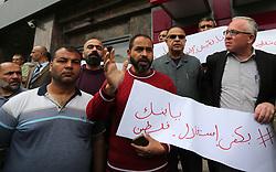 May 2, 2019 - Gaza City, Gaza Strip, Palestinian Territory - Palestinians take part in a protest outside Palestine Bank in Gaza City on May 2, 2019  (Credit Image: © Ashraf Amra/APA Images via ZUMA Wire)