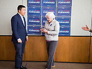 22 JANUARY 2020 - CHARLES CITY, IOWA: ANDREW YANG waits for a woman to set up her phone for a selfie at a campaign event in the public library in Charles City, IA. Yang, an entrepreneur, is running for the Democratic nomination for the US Presidency in 2020. He is in northern Iowa as a part of his 17 day bus tour across the state. Iowa hosts the the first election event of the presidential election cycle. The Iowa Caucuses will be on Feb. 3, 2020.       PHOTO BY JACK KURTZ