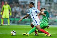 England (7) Raheem Sterling, Slovenia (7)Josip Iličić during the FIFA World Cup Qualifier match between England and Slovenia at Wembley Stadium, London, England on 5 October 2017. Photo by Sebastian Frej.