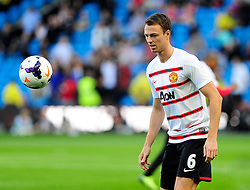 Manchester United's Jonny Evans - Photo mandatory by-line: Dougie Allward/JMP - Tel: Mobile: 07966 386802 22/09/2013 - SPORT - FOOTBALL - City of Manchester Stadium - Manchester - Manchester City V Manchester United - Barclays Premier League