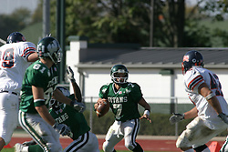 22 October 2005: Titans QB Tom Kudyba slips back into a well protected pocket. The Illinois Wesleyan Titans posted a 23 - 14 home win by squeeking past the Thunder of Wheaton College at Wilder Field (the 5th oldest collegiate field in the US) on the campus of Illinois Wesleyan University in Bloomington IL