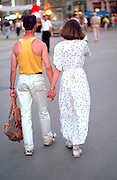 Couple age 40 walking hand in hand.  Krakow Poland