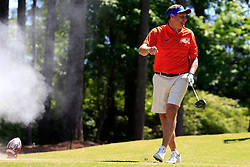 Dan Mullen gets pranked with an exploding golf ball during the Chick-fil-A Peach Bowl Challenge at the Oconee Golf Course at Reynolds Plantation, Sunday, May 1, 2018, in Greensboro, Georgia. (Paul Abell via Abell Images for Chick-fil-A Peach Bowl Challenge)