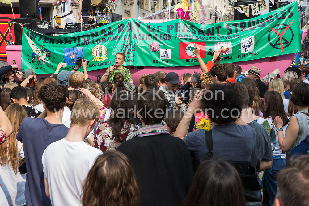 London, UK. 17th April 2019. Chris Packham, naturalist, television presenter and author, addresses climate change activists from Extinction Rebellion at Oxford Circus on the third day of International Rebellion activities to call on the government to take urgent action to combat climate change.