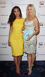 (R-L) PIXIE LOTT with MYLEENE KLASS arrives for the Radio Academy Awards, London, United Kingdom. Monday, 12th May 2014. Picture by i-Images
