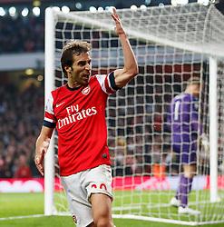 Arsenal Midfielder Mathieu Flamini (FRA) celebrates scoring a goal to equalise at 1-1 as Man City Goalkeeper Joe Hart (ENG) looks dejected in his goal - Photo mandatory by-line: Rogan Thomson/JMP - 07966 386802 - 29/03/14 - SPORT - FOOTBALL - Emirates Stadium, London - Arsenal v Manchester City - Barclays Premier League.