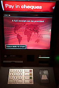 HSBC ATM cashpoint machine with touch screen and key pad.