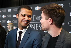 Jacob Anderson (let) and Joe Dempsie attending the Game of Thrones Premiere, held at Waterfront Hall, Belfast.
