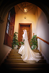 Bride on staircase at the beautiful Ashridge House