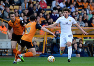 Kalvin Phillips closes down Jack Price during the Sky Bet Championship match between Wolverhampton Wanderers and Leeds United at Molineux, Wolverhampton, England on 6 April 2015. Photo by Alan Franklin.