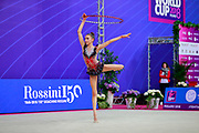 Stoyanova Anna Krasteva during qualifying at hoop in Pesaro World Cup 13 April 2018. Anna is an Norvegian individual rhythmic gymnast of Bulgarian origins. She was born in Sofia, Bulgaria,2002. Her goal is compete at the 2020 Olympic Games in Tokyo.