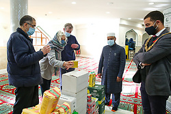 © Licensed to London News Pictures. 01/12/2020. London, UK. ADAM JOGEE (R), Mayor of Haringey attends the London Islamic Cultural Society, also known as Wightman Road Mosque in north London as they donate halal food to the FoodBank at the Gospel Church. Muslim families visiting the foodbank during the COVID-19 lockdowns have appealed for help with food items, especially halal food. Photo credit: Dinendra Haria/LNP