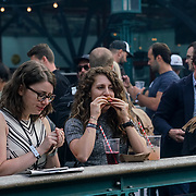 London, UK. 1st September 2017. Hundreds attend the last Summer day meats lovers Meatopia festival with live music, food and drinks throughtout the weekend at Tobacco Dock.
