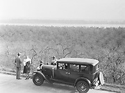 9904-A166. Prune orchard in Clark County, Washington state. New Hupmobile Century Six Sedan. Photographed by the Oregonian and published 28 April 1929