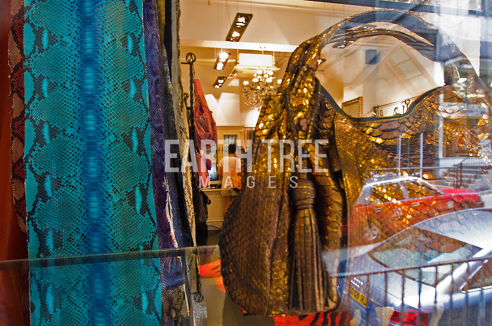 A shop front displays python skins from Indonesia in Hong Kong, China, 08 October 2010. Snakeskin has become the latest must-have and designer labels including Jimmy Choo, Donna Karan, Mulberry, Gucci, Prada, Roberto Cavalli and Yves Saint Laurent have all used it in coats, bags and boots, claiming it is farmed, but according to TRAFFIC, the international wildlife trade monitoring network, python take too long to mature and are too expensive to rear in captivity. EPA/Paul Hilton Wild animal market, Guangzhou, China. Photo: Paul Hilton for Earth Tree Images