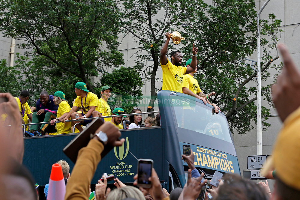 Monday 11th November 2019.<br /> City Hall, Grand Parade,<br /> And City Centre, Cape Town,<br /> Western Cape,<br /> South Africa.<br /> <br /> SPRINGBOKS CELEBRATE WINNING THE RUGBY WORLD CUP CHAMPIONSHIP IN 2019 WITH A COUNTRYWIDE VICTORY TOUR!<br /> <br /> SPRINGBOKS RUGBY WORLD CUP VICTORY TOUR CAPE TOWN!<br /> <br /> South African Captain Siya Kolisi holds the Web Ellis Cup aloft as he celebrates with his team mates and excited fans taking photos and selfies while they celebrate the Springboks driving past in their open top bus in the Cape Town City Centre.<br /> <br /> The reigning Rugby World Cup Champions namely the South African Springbok Rugby Team, celebrates winning the Webb Ellis Cup during the International Rugby Football Board Rugby World Cup Championship held in Japan in 2019 with their Victory Tour that culminated in the final city tour taking place in Cape Town. Thousands of South African fans filled the streets of the city all trying their best to show their support for their beloved Springboks and to celebrate them winning the Rugby World Cup for the third time. South Africa previously won the Rugby World Cup in 1995, 2007 and now again in 2019. South African Springbok Captan Siya Kolisi took the opportunity to speak to the gathered crowd about how something like this brings unity and that we should live together as a nation that practices what is known as ubuntu. Ubuntu is a quality that includes the essential human virtues of compassion and humanity. This image taken in Cape Town on Monday 11th November 2019.<br /> <br /> This image is the property of Seven Bang Media Group (Pty) Ltd, hereinafter referred to as SBM.<br /> <br /> Picture By: SBM / Mark Wessels. (11/11/2019).<br /> +27 (0)61 547 2729<br /> mark@sevenbang.com<br /> www.sevnbang.com<br /> <br /> Copyright © SBM. All Rights Reserved.