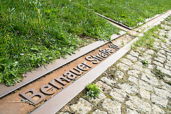 Plaque marks location of Berlin Wall in  former death strip of Berlin Wall on Bernauer Strasse and Ackerstrasse in Berlin Germany
