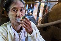 BAGAN, MYANMAR - CIRCA DECEMBE 2013: Old Burmese woman smoking a cigar in the Nyaung U market close to Bagan in Myanmar